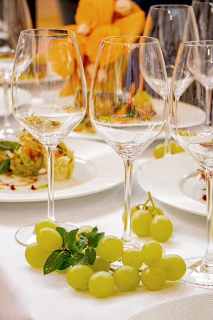 wedding festive table champagne glasses and bunches of grapes