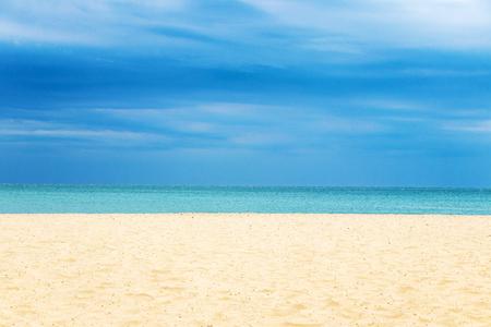 sandy beach blue sea and blue sky on the horizon
