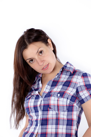 Young attractive woman in plaid shirt, isolated, casual stile. Archivio Fotografico