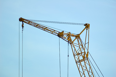 big construction crane part on blue sky background 版權商用圖片