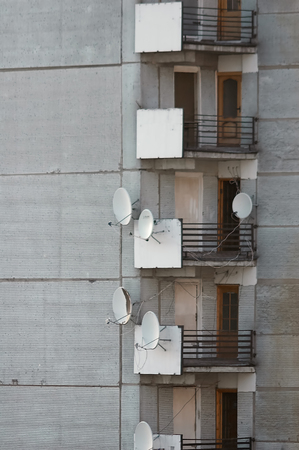 block of flats with satellite dish antennas