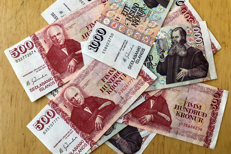 Icelandic cash. Money of Iceland. Several Icelandic krona bills on wooden table. Icelandic krona is the national currency of Iceland (kronur) 写真素材