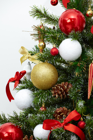 Closeup of a decorated Christmas tree, isolated white background Banco de Imagens