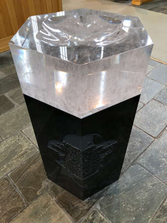 REYKJAVIK, ICELAND - July 2, 2018: The baptismal font inside Hallgrimskirkja Lutheran parish church. It is from 2001, combines a base of Icelandic basalt and a bowl of Czech lead crystal.
