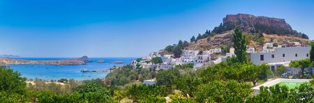 Greece trip in summer, panorama of Lindos city of Rhodes island, beautiful architecture of the city. Standard-Bild