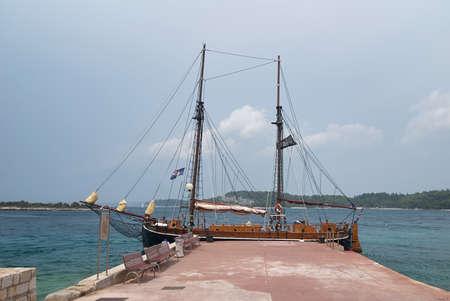 Rovinj, Croatia - August 30, 2007: Colorful wooden ship, the Pirate galleon, docked at the pier near hotel Istra (Istria region, Adriatic seashore).