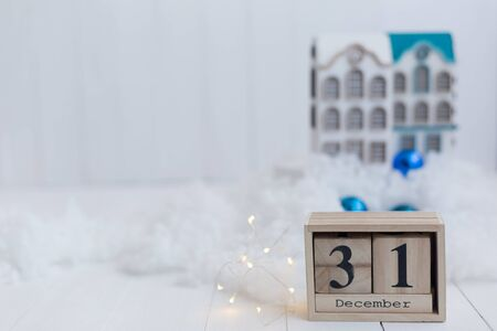 Beautiful wooden calendar on a beautiful winter background with a dolls house Stock Photo
