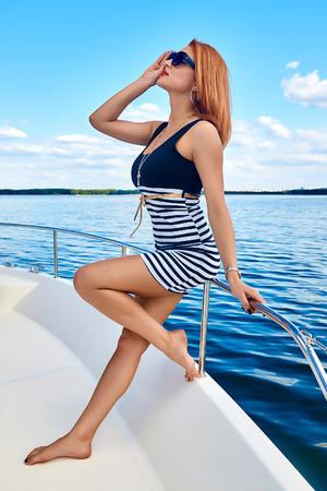 Beautiful girl on a yacht Stock Photo