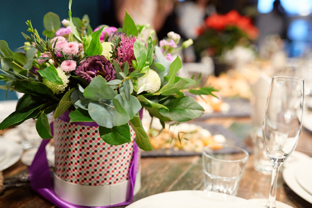 formal dinner party: a bouquet of flowers at the banquet table in a restaurant Stock Photo