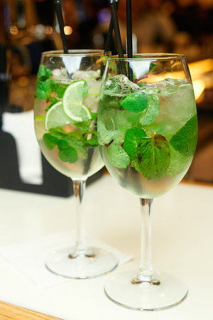 Two mojito cocktails on the bar in the restaurant Stock Photo