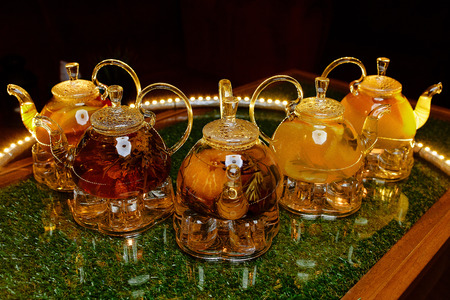 Glass teapots with tea on the table in a cafe