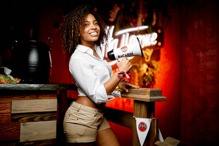 """Fashion photo of beautiful waitress in a bar with horn in white shirt """"BACARDI"""" Editorial"""