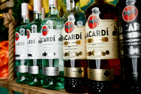 """Great photo of bottles with rum """"BACARDI"""" on shelf"""