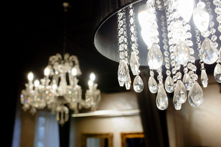 Great closeup photo of crystal chandelier on the black background