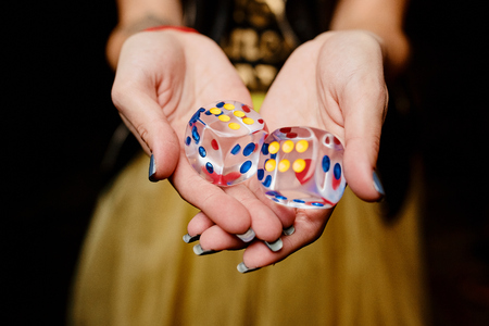 Photo of dice in the hand of  girl