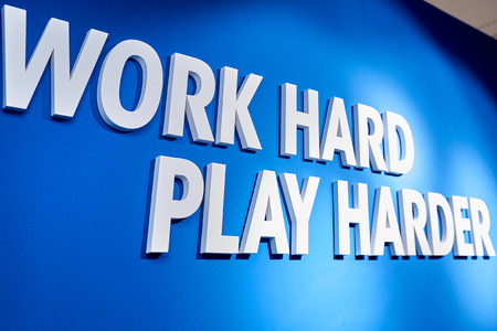 blue motivating plate with white letters with phrase Work hard, Play harder