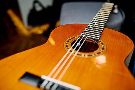 classical brown guitar with six strings in the restaurant