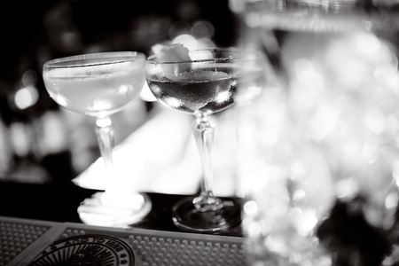 two champagne saucers on a table on the bar Stockfoto