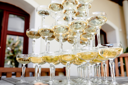 glasses of champagne on the table outside at a wedding