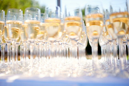 champagne glasses on a table in a restaurant Imagens