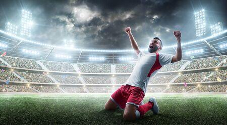 Soccer player celebrates winning the open stadium. Joy of life