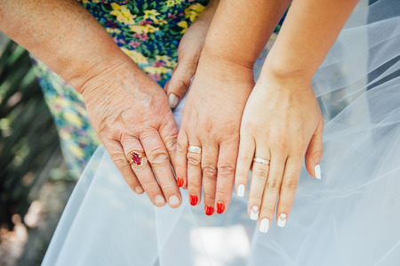 three generation: Happy love couple holding hands in the morning three generation