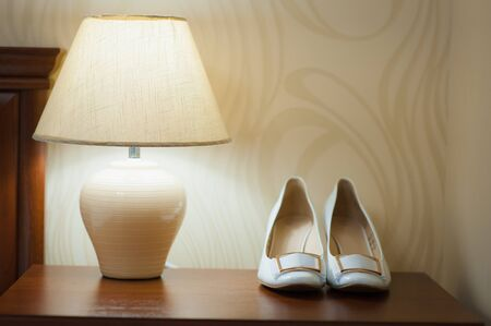 foot gear: beautiful white shoes from bride with a lamp