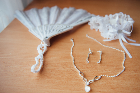 perls: Word Love made by bridal wedding accessories on dressing table