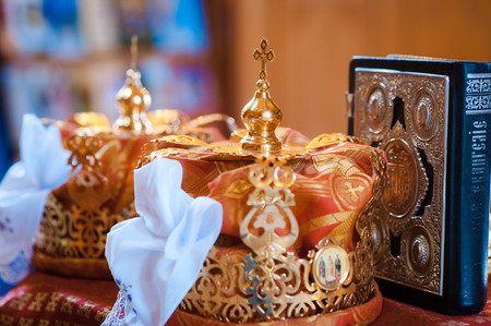 bible altar: luxury golden crowns with stones for the wedding ceremony in the old church gold