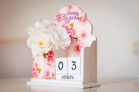 manacles: beautiful pink calendar as a souvenir date 03 oktober