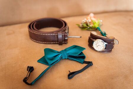 suede belt: Set of groom clothes. Wedding rings, shoes, cufflinks and bow tie detalis