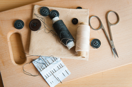 still life various sewing accessories in the scheme needle thread buttons