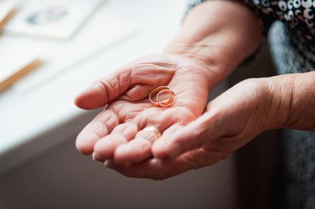tender sentiment: Hand 86th-years old Ukrainian women holding rings