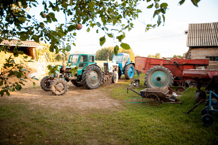 vineyard plain: defective tractor with trailer standing in the yard Ukraine