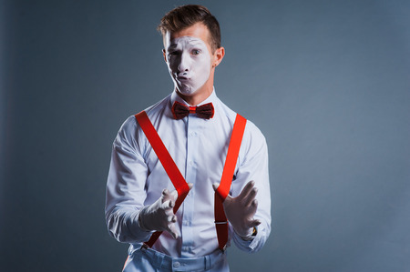 droll: studio shot of two mimes isolated on gray background