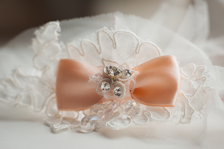 perls: close up by bridal wedding accessories on dressing table. Stock Photo