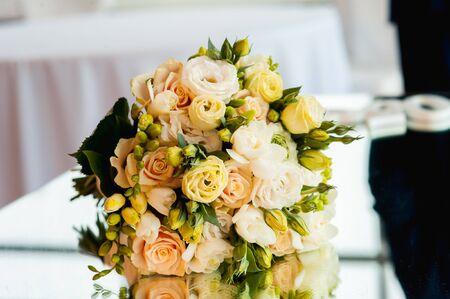 premium Wedding bouquet of roses on the luxury mirror table Stock Photo