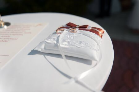 booked: pair of  wedding rings with bokeh background paper