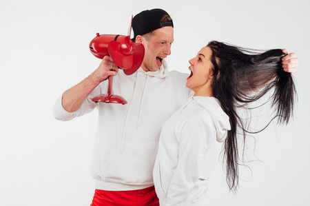 studio shot of two people with fan isolated on a white background Stock Photo