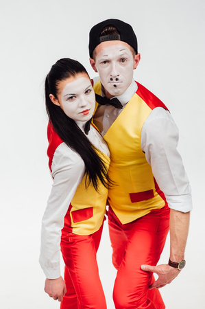 droll: studio shot of two mimes isolated on a white background