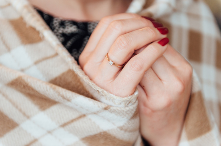 maltreatment: adult woman with a ring on his hand hid rug in the cage Stock Photo
