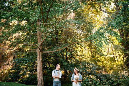stride: Happy girl and her boyfriend walking in park.