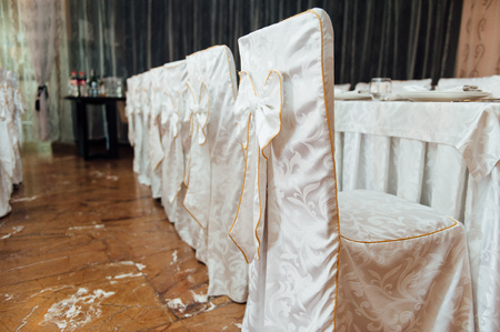 catered: chair set for wedding or another catered event dinner ceremony
