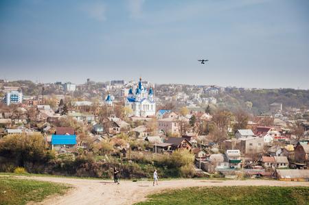 govern: quadrocopter drone in flight in a sky.
