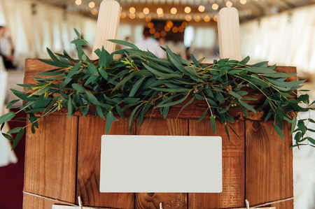 wooden bucket: Original vintage wooden board with decoration and ribbons and a guest list, heart and bucket in the background. with a place for an inscription