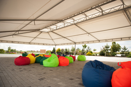 beanbag: many colorful soft beanbag seats. under a canopy for relaxing Stock Photo