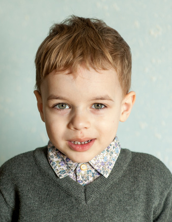 disbelieve: Little man is suprised and so happy about it. Closeup headshot. emotion card