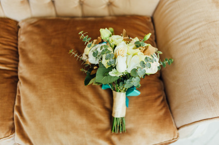 david brown: Bridal bouquet of roses on a brown brown chair Stock Photo
