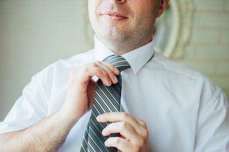 Portrait of a Man in a room near a window.