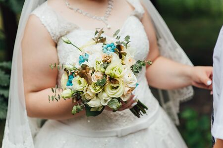 light hair: beautiful bouquet in hands of the very fat bride is very stylish with light hair